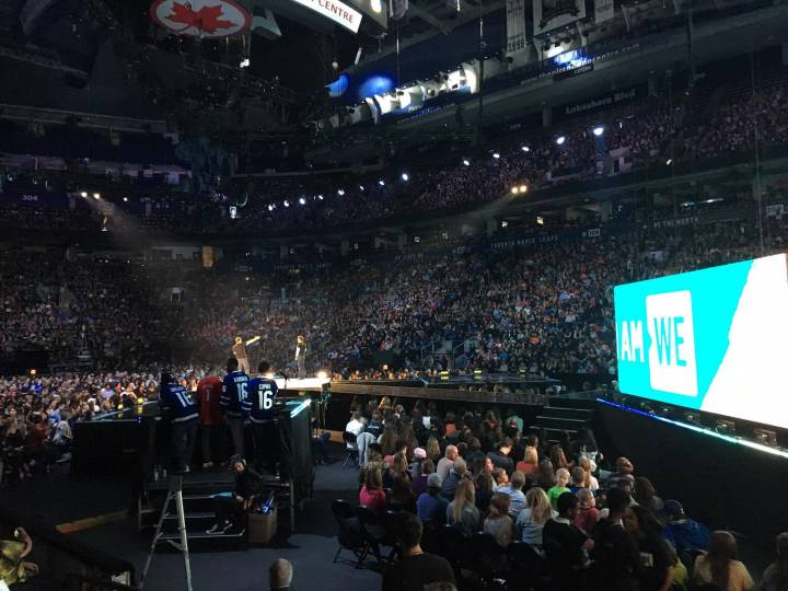 WE Charity co-founder Craig and Marc Kielburger addressing the crowd at WE Day Family. (Photo credit: Sarah Chew/RUtv News)