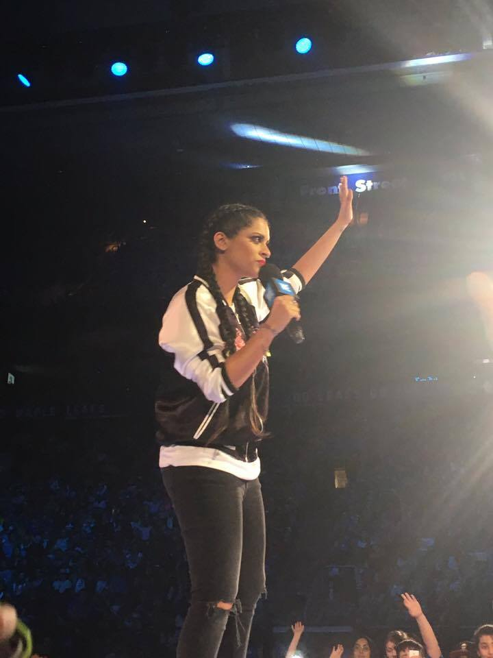 Lilly Singh speaking on stage at WE Day Family. (Photo credit: Gabrielle Reyes/RUtv News)