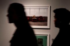 Attendees of the Flash Forward/Flash Back installation examine the photography at the Ryerson Image Centre. (Photo credit: Emma Sandri/RUtv News)