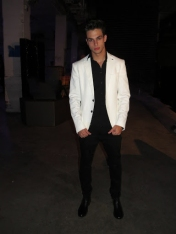 Giovanni from ModèlesLCP rocking a white jacket. (Photo credit: Jessica Tucciarone/RUtv News)