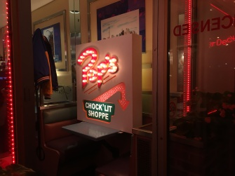 The Riverdale diner photo area with Archie's jacket and Pop's Chock'lit Shoppe sign. (Photo credit: Jasmine Bala/RUtv News)