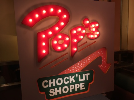 Lit-up Pop's Chock'lit Shoppe sign at Fran's Restaurant on College Street. (Photo credit: Jasmine Bala/RUtv News)