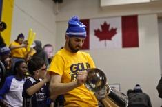 In-game host Ivan Derakshani gets the crowd going during the first T-shirt toss (Photo credit: Brent Smyth/RUtv News).