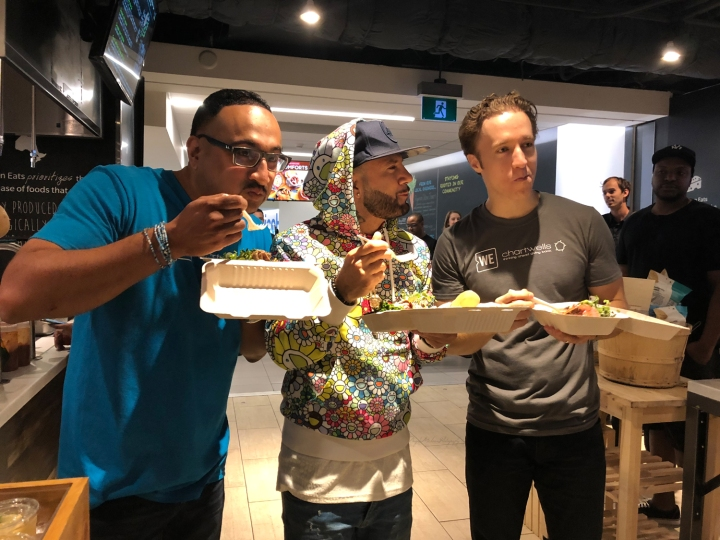 Ashton Sequeira, Karl Wolf and Craig Kielburger trying the WE Special